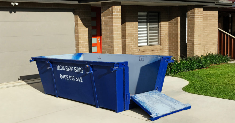 4 cubic metre skip bin with easy-load doors in driveway of home in Sutherland